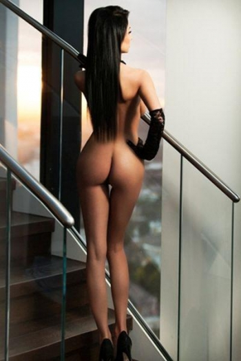 Vanessa naked on the stairs showing off her bum and curves