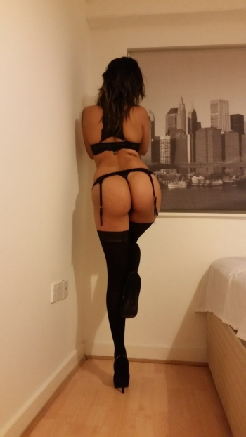Brunette Jasmine wearing black stockings posing from behind
