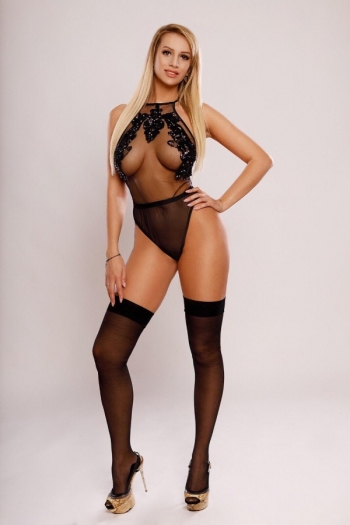 Yasmin posing wearing stockings and black one-piece lingerie
