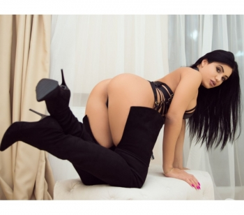 Lexi on all fours in black bodysuit and thigh high boots