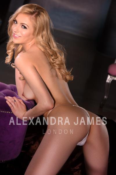 Italian London escort Bella topless in white panties