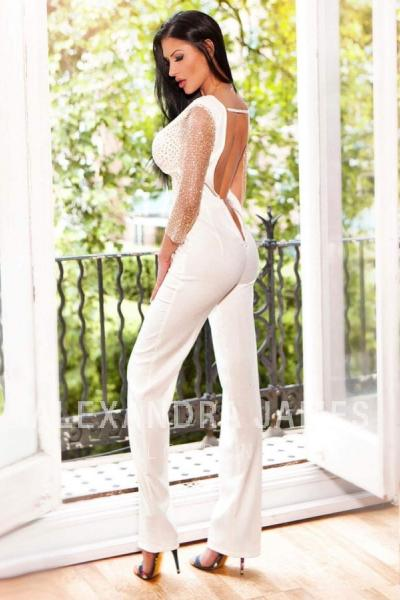 Adine showing off her bum in a tight white jumpsuit