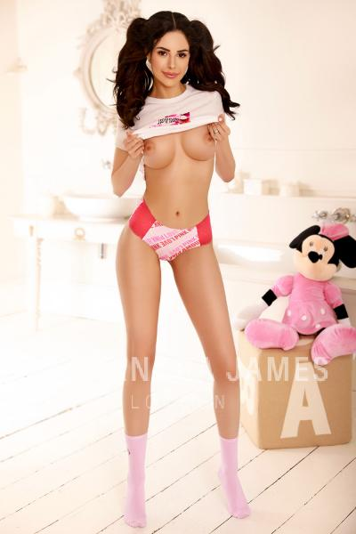 Francesca with pigtails wearing white and pink panties with her breasts shown